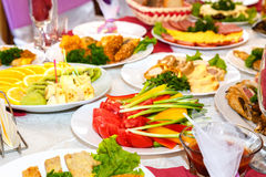 Salads and dishes on banquet table Royalty Free Stock Image