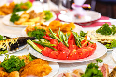 Salads and dishes on banquet table Stock Photo