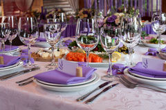 Salads and empty wine glasses set in the restaurant Royalty Free Stock Image