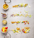 Salads in jars and ingredients on light stone background, top view Royalty Free Stock Photos