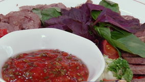 Salads, meat, fish, fruit, strawberries on table. stock video