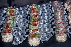 Salads with meat in a glass jar stock image