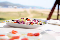 Salads in a outdoor restaurant table Stock Images