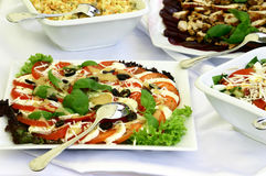 Salads and platters royalty free stock photography