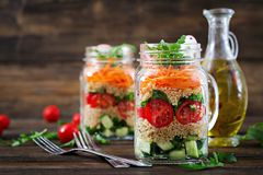 Salads with quinoa, arugula, radish, tomatoes and cucumber royalty free stock photos