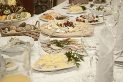 Salads and snacks are on the festive table Royalty Free Stock Photos