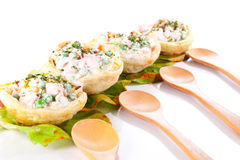 Salads in tortilla and spoons Stock Photos