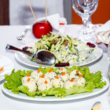 Salads on white banquet table Stock Photography