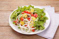 Salads. On a wooden background Royalty Free Stock Photos
