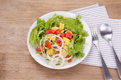 Salads. On a wooden background Stock Photo