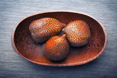 Salak or snake fruit in a wooden plate Royalty Free Stock Image