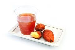 Salak vermelho e suco Fotografia de Stock Royalty Free