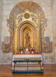 Salamanca - The baroque polychrome side altar of St. Martin de Porres in church Convento de San Esteban Stock Photo