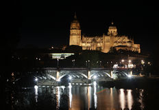 Salamanca at Night - Iron bridge with Cathedral. Reflecting in the Tormes river Royalty Free Stock Images