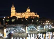 Salamanca skyline at night and Enrique Esteban Bridge over Tormes River royalty free stock photo