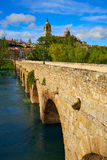 Salamanca skyline and roman bridge on Tormes Stock Photos