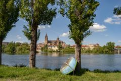 Salamanca skyline with Tormes river boats in Spain royalty free stock photo