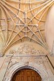 SALAMANCA, SPAIN, APRIL - 16, 2016: The gothic archs of atrium and baroque portal of monastery Convento de San Esteban Stock Photography