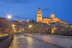 SALAMANCA, SPAIN: The Cathedral and bridge Puente Romano over the Rio Tormes river at dusk. Stock Image