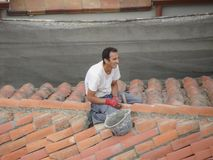 Mason working on the roof Royalty Free Stock Photography