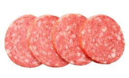 Salame affettato della salsiccia isolato su fondo bianco Vista superiore fotografia stock
