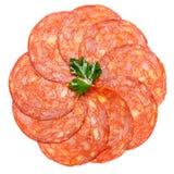 Salame italiano o chorizo spagnolo su fondo bianco Fotografia Stock Libera da Diritti