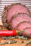 Salame, peperoncino rosso e pepe Immagine Stock
