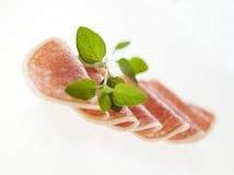 Salame rosso ed erbe verdi Fotografie Stock Libere da Diritti