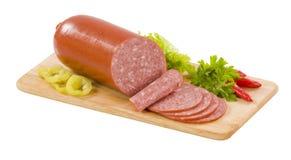 Salami. Sausage of salami on a cutting boardi royalty free stock image