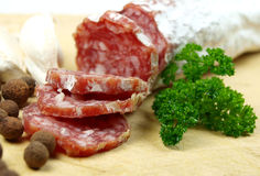 Salami. With various spices and parsley royalty free stock images