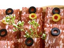 Salami. Original italian salami with rosemary and olives stock photography