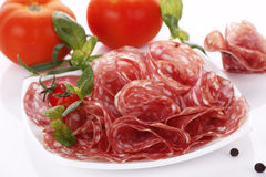 Salami. Very tasty sliced salami with herbs Royalty Free Stock Image