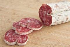 Salami. Sliced Italian Salami on a cutting board stock photography