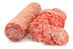 Salami. Sliced salami isolated on a white background royalty free stock images