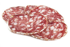 Salami. Sliced on the white stock photography
