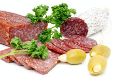 Salami. Sliced salami with parsley and olives Royalty Free Stock Photos