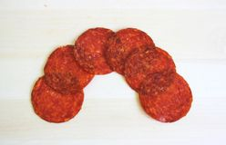 Salami. Some salami on a desk stock images