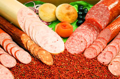 Salami. Sliced salami with bread and vegetables stock photography