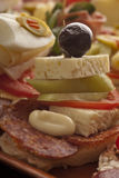 Salami appetizer topped with feta and olives Royalty Free Stock Photos