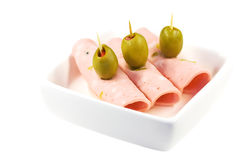 Salami appetizers. With green olives Royalty Free Stock Photos