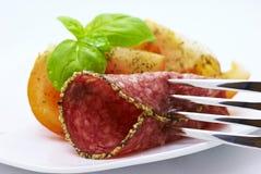 Salami avec des tomates Photographie stock