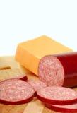 Salami avec du fromage et des casseurs Photographie stock