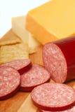 Salami avec du fromage et des casseurs Photos stock