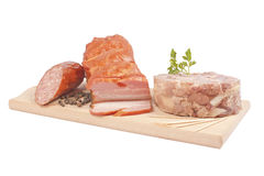 Salami, bacon, aspic on chopping board Stock Photo