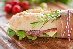 Salami baguette. Freshly topped baguette with salami, cheese and  rucola Royalty Free Stock Photo