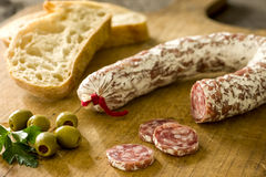 Salami with baguette and olives Stock Photo