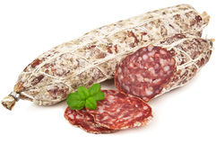 Salami and basil leaves Stock Photos