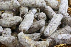 Salami of boar. Background for sale in the Italian delicatessen royalty free stock image