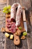 Salami on board Stock Images