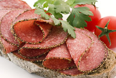 Salami Bread. Bread with Pepper Salami and tomatose royalty free stock image